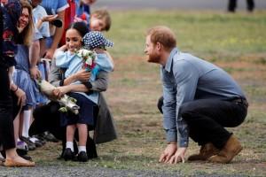 Harry e Maghan con il bambino