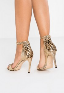 Sandali oro Katy Perry 140€
